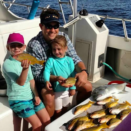 family fishing off the coast of Maui